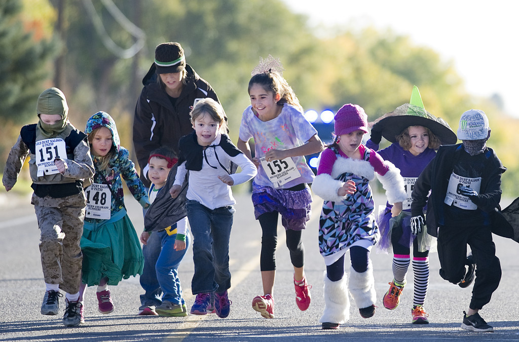 CHIEFTAIN PHOTO/BRYAN KELSEN Some of the costume-clad youngsters taking part in the Mini Monster Dash 50 yard run begin their run from the starting line Saturday morning at DiSanti Farms on South Road. The free race was just prior to the Monster Dash 5K run to benefit the Junior League of Pueblo. See story, Page 5B.